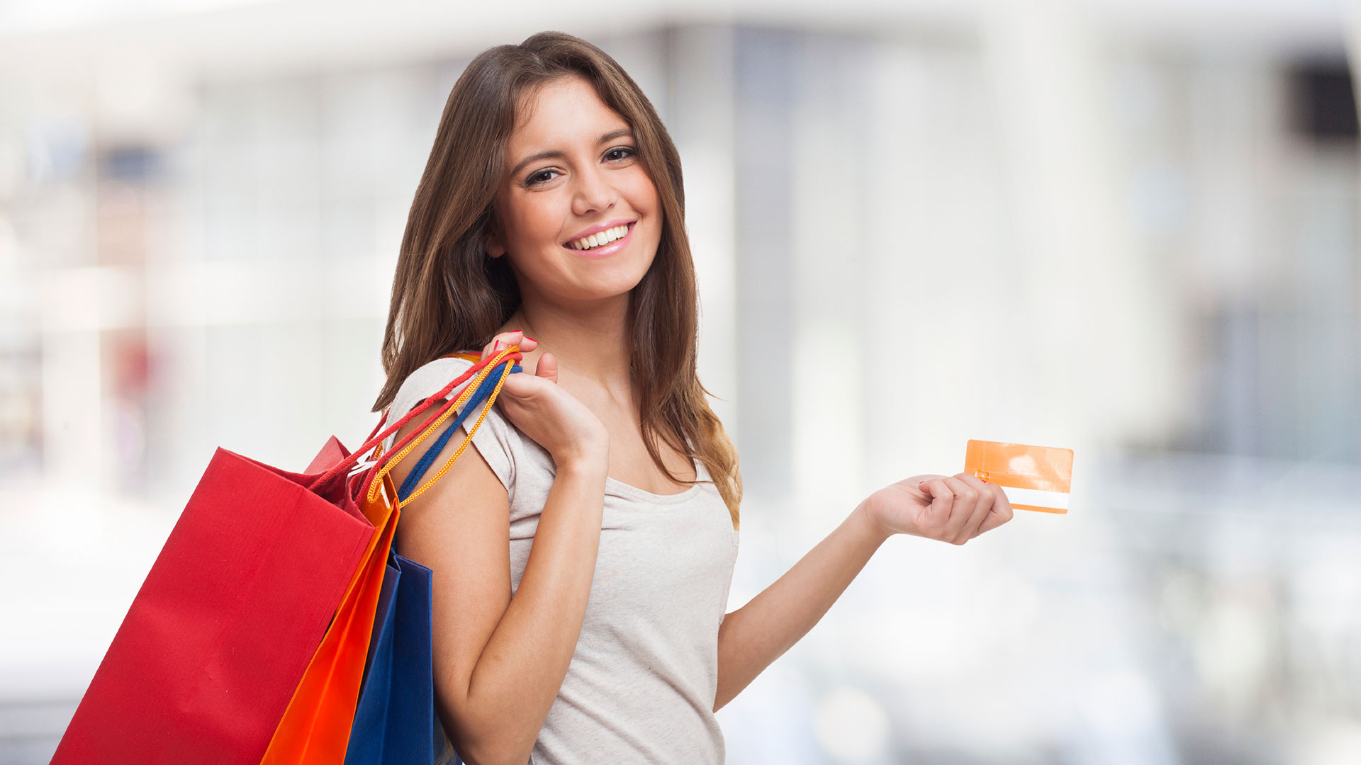 young woman shopping with gift card